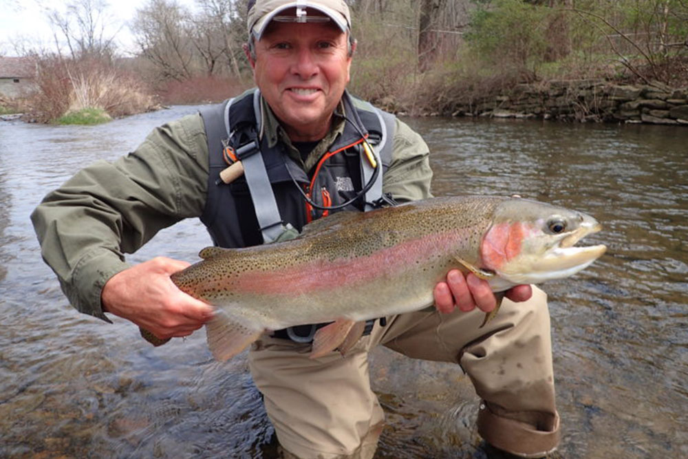 Man with Large Rainbow Trout