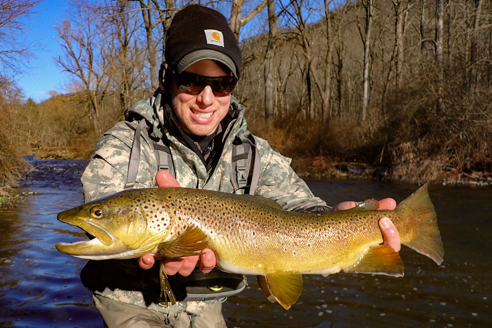 Man holding a trophy trout
