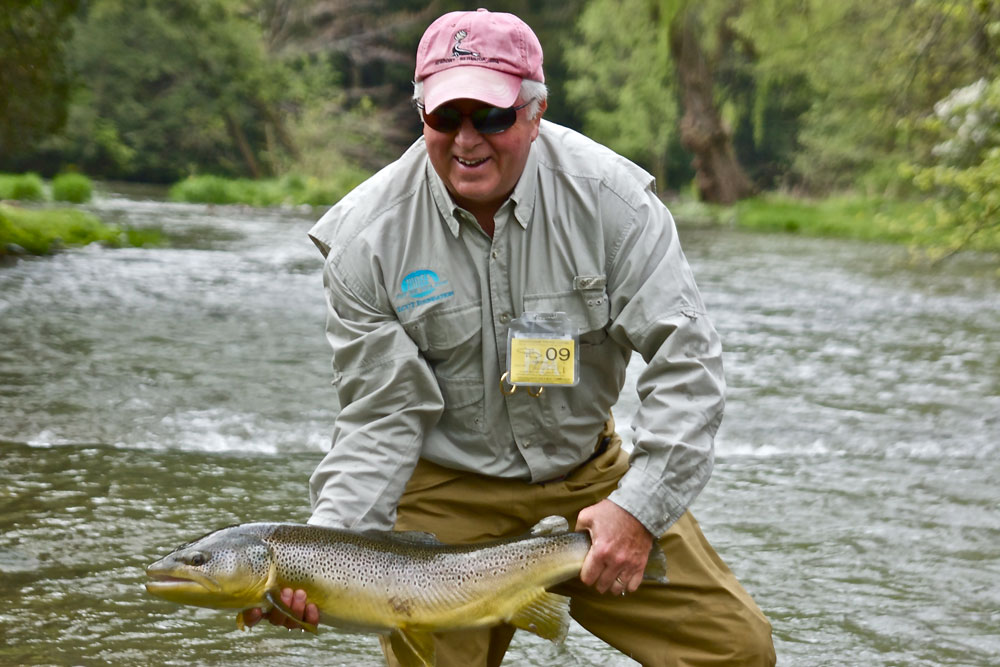 Man holding trophy brown trout